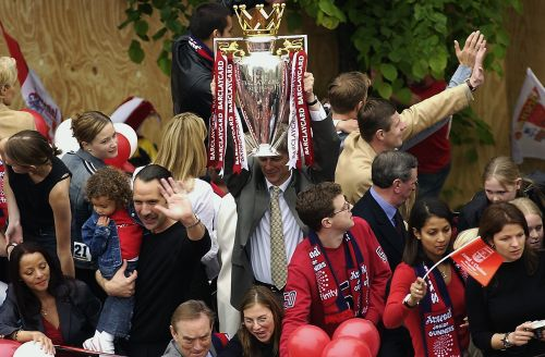 Arsenal manager Arsene Wenger lifting the Premiership trophy during Arsenal's open top bus parade