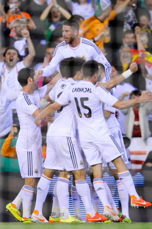 Real Madrid players celebrate after scoring a goal