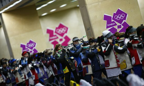 Competitors participate in the women's 10m air rifle qualification competition