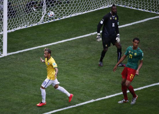 Brazil's Neymar (L) celebrates after scoring against Cameroon during their 2014 World Cup