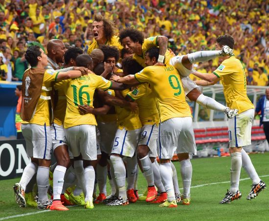 Brazilian players celebrate after scoring