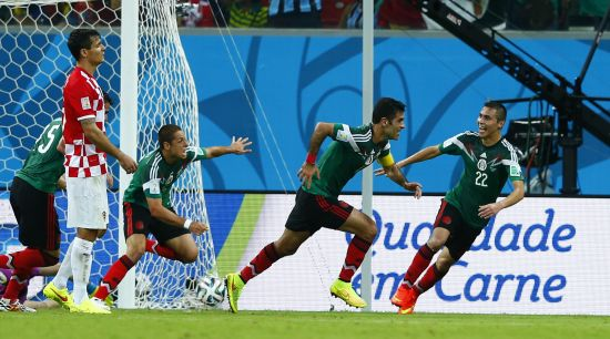 Mexico's Rafael Marquez (C) celebrates after scoring a goal with teammates (L-R) Hector Moreno, Javier Hernandez and Paul Aguilar