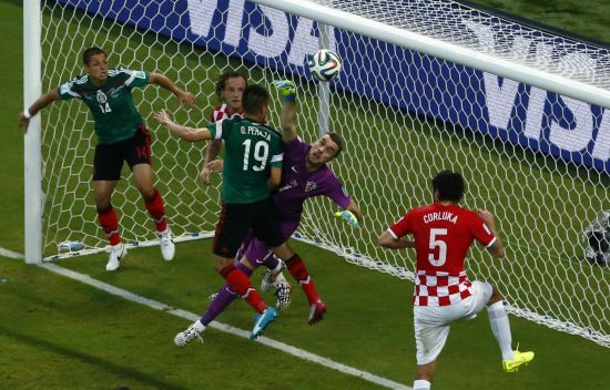 Croatia's goalkeeper Stipe Pletikosa (1) saves the ball in front of Mexico's Oribe Peralta (19)