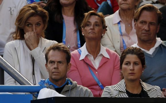 Mirka Federer and Stefan Edberg watches the game