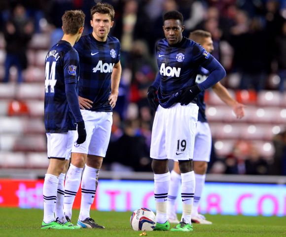 Manchester United players after losing a game