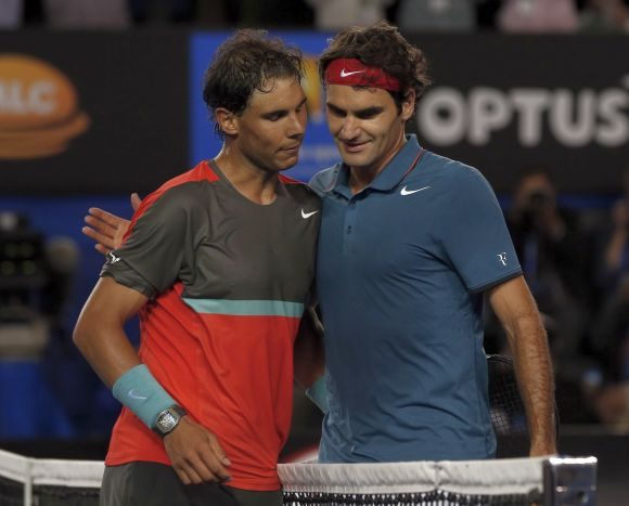 Rafael Nadal (L) of Spain and Roger Federer of Switzerland