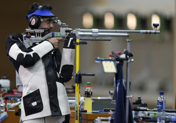 Abhinav Bindra competes in the 10m air rifle at Barry Buddon Shooting Centre during day two of the Glasgow 2014 Commonwealth Games