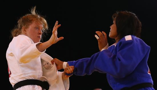 Catherine Arscott of Australia (white) competes againsts Sunibala Huidrom of India in the Judo 70kg at SECC Precinct during day two of the Glasgow 2014 Commonwealth Games