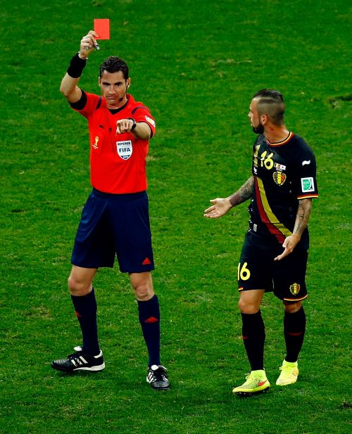 Referee Benjamin Williams shows the red card to Steven Defour of Belgium