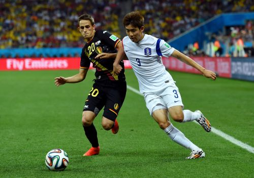 Adnan Januzaj of Belgium and Yun Suk-Young of South Korea compete for the ball