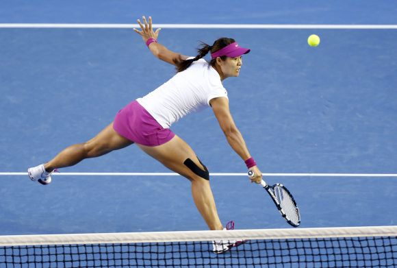 Li Na of China hits a return to Dominika Cibulkova of Slovakia