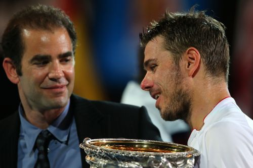 Pete Sampras presents Stanislas Wawrinka of Switzerland with the Norman Brookes Challenge Cup