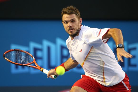Stanislas Wawrinka of Switzerland plays a forehand in his men's final match against Rafael Nadal of Spain