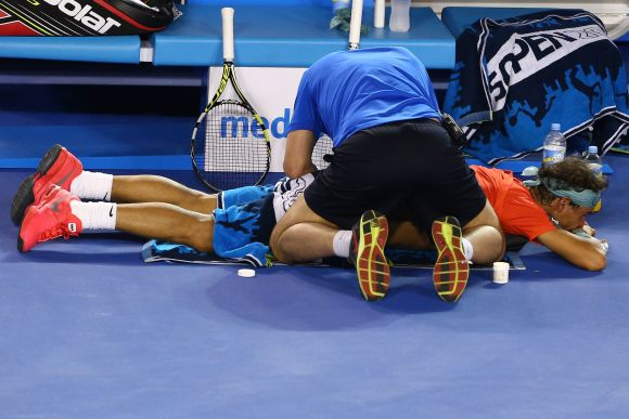 Rafael Nadal of Spain receives a back massage