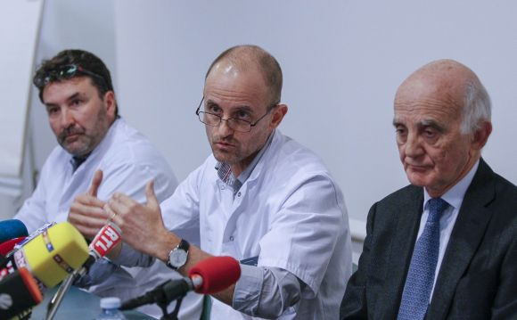 Jean-Francois Payen (C), head anaesthetician at the CHU hospital, neurosurgeon Stephan Chabardes (L) and Professor Gerard Saillant, President of the Institute for Brain and Spinal Cord Disorders (ICM), attend a news conference at the CHU Nord hospital emergency unit in Grenoble
