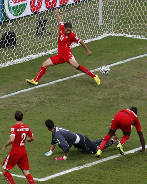 Switzerland's Ricardo Rodriguez (13) makes a save