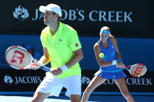 Kristina Mladenovic plays a backhand in her mixed doubles final match with Daniel Nestor against Sania Mirza and Horia Tecau