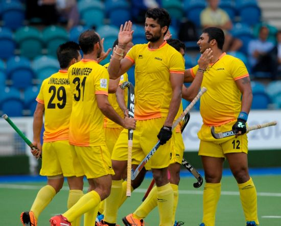 Indian players celebrate after scoring
