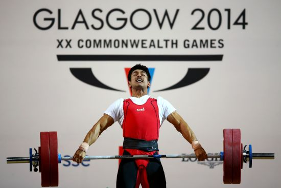 Omkar Otari of India competes in the Men's 69kg weightlifting final at the Clyde Auditorium