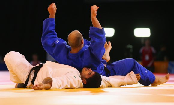 Jake Andrewartha of Australia competes against Parikshit Kumar of India in the Men's +100kg Judo bronze medal contest