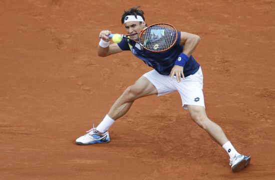 David Ferrer of Spain hits a return to Igor Sijsling of the Netherlands during their men's singles match