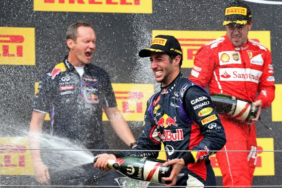 Daniel Ricciardo of Australia and Infiniti Red Bull Racing celebrates victory on the podium