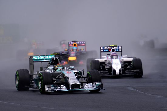 Nico Rosberg of Germany and Mercedes GP leads Valtteri Bottas of Finland and Williams and Sebastian Vettel of Germany and Infiniti Red Bull Racing into turn two during the Hungarian Formula One Grand Prix
