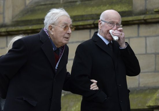 Doug Ellis (L) and Bobby Charlton arrive for the funeral of former Preston and England soccer player Tom Finney at Preston Minster