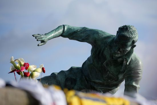 Flowers and tributes adorn the statue of Sir Tom Finney at Deepdale Stadium