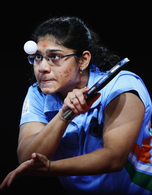 Madhurikaa Paatkar of India serves against Ziyu Zhang of Australia during the Women's Team bronze medal match