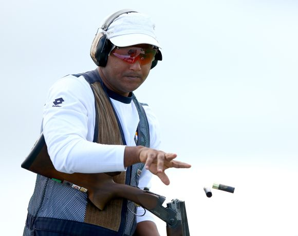 Asab Mohd of India in action during the Men's Double Trap final at Barry Buddon Shooting Centre