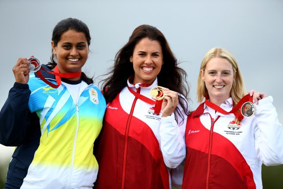 The medalists (L-R) Shreyasi Singh of India (Silver) Charlotte Kerwood of England (Gold) and Rachel Parish of England (Bronze) celebrate on the podium after the Women's Double Trap final at Barry Buddon Shooting Centre