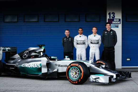 Paddy Lowe the Mercedes GP Executive Director (Technical), Lewis Hamilton of Great Britain and Mercedes GP, Nico Rosberg of Germany and Mercedes GP and Toto Wolff the Mercedes GP Executive Director unveil the new Mercedes W05