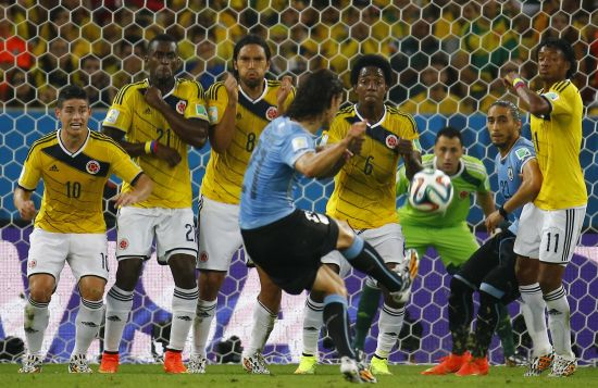 Uruguay's Edinson Cavani takes a free kick but fails to score a goal against Colombia