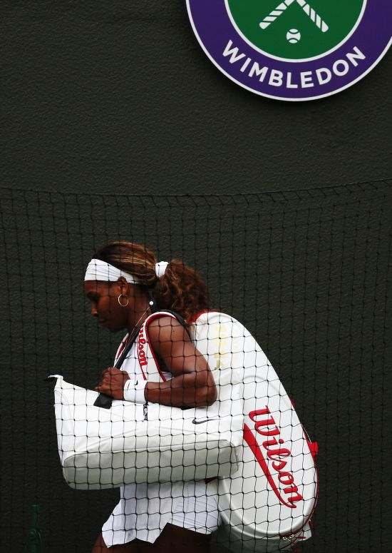 Serena Williams of the United States walks of dejected after losing her Ladies' Singles third round match to Alize Cornet of France