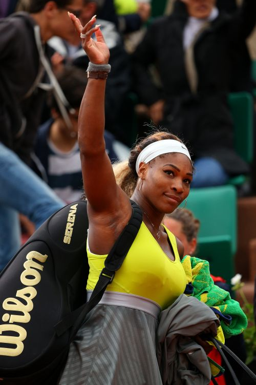 Serena Williams of the United States waves to the crowd as she l