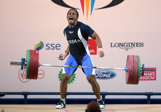 Sathish Sivalingam of India celebrates during the Men's Weightlifting 77kg category at Scottish Exhibition And Conference Centre