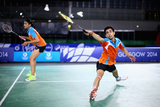 R V Gurusaidutt (r) and Ashwini Ponnappa of India in action in thier mixed doubles match against Danny Chrisnanta and Vanessa Neo of Singapore in the Mixed Team Bronze medal final
