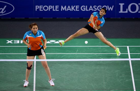 Ashwini Ponnappa and Jwala Gutta of India in action during their women's doubles match against Shinta Mulia Sari and Lei Yao of Singapore in the Mixed Team Bronze medal