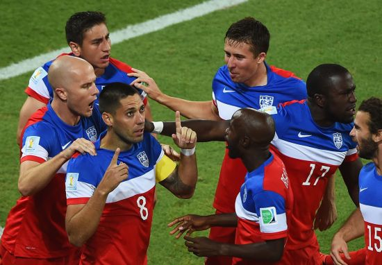 Clint Dempsey of the United States celebrates with teammates after scoring his team's first goal