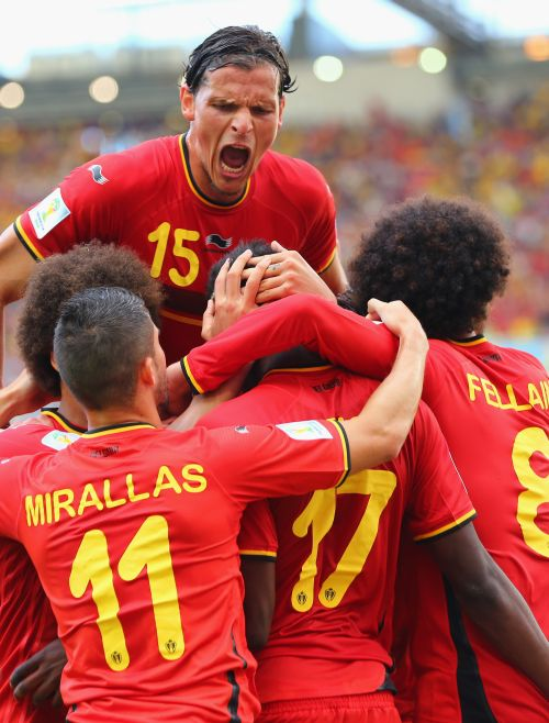 Divock Origi of Belgium (center) celebrates scoring his team's first goal