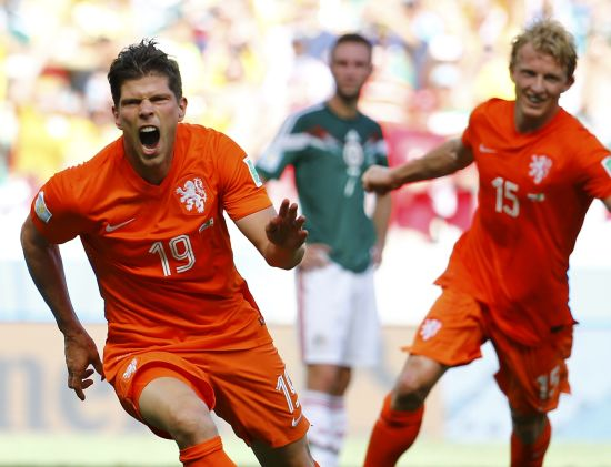 Klaas-Jan Huntelaar (L) and Dirk Kuyt of the Netherlands celebrate Huntelaar's goal