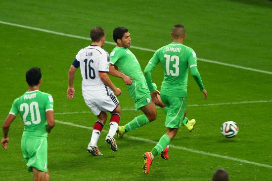 Abdelmoumene Djabou of Algeria shoots and scores his team's first goal in extra time