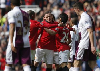 Rooney double helps United lift Old Trafford gloom