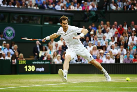 Andy Murray of Great Britain his a forehand return during his Gentlemen's Singles fourth round match against Kevin Anderson of South Africa