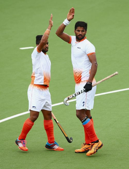 Rupinder Singh of India celebrtaes after scoring a goal during the men's preliminaries match between India and Australia A