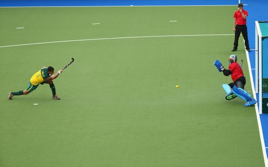 Chris Ciriello of Australia scores a penaty shot past Sreejesh Parattu Raveendran of India