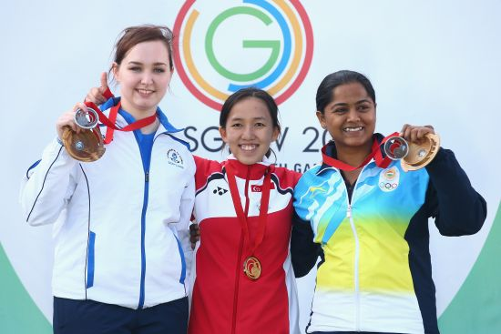 old medalist Jasmine Ser of Singapore, Jen McIntosh of Scotland and Bronze medalist Lajja Gauswami of India after the 50m Rifle 3 positions final at Barry Buddon Shooting Centre