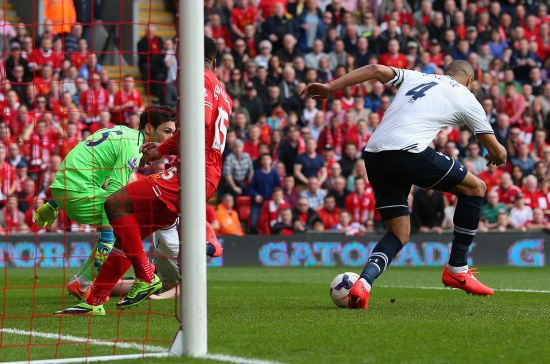 Younes Kaboul of Tottenham Hotspur scores an own goal during the Barclays Premier League match