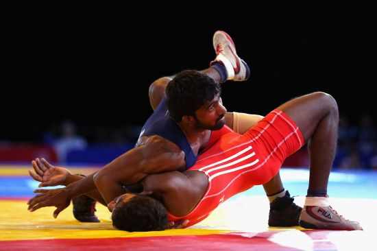 Yogeshwar Dutt of India defeats Chamara Perera of Sri Lanka in the semi-final of the 65kg men's Wrestling at Scottish Exhibition And Conference Centre